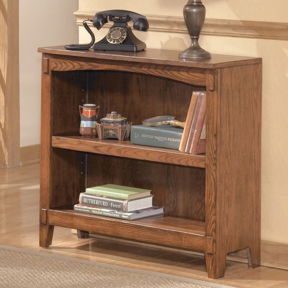 Signature Design by Ashley Cross Island Bookcase - Enhance the look of your living area, office, or bedroom while also adding much-needed storage with a Signature Design By Ashley Cross Island ...