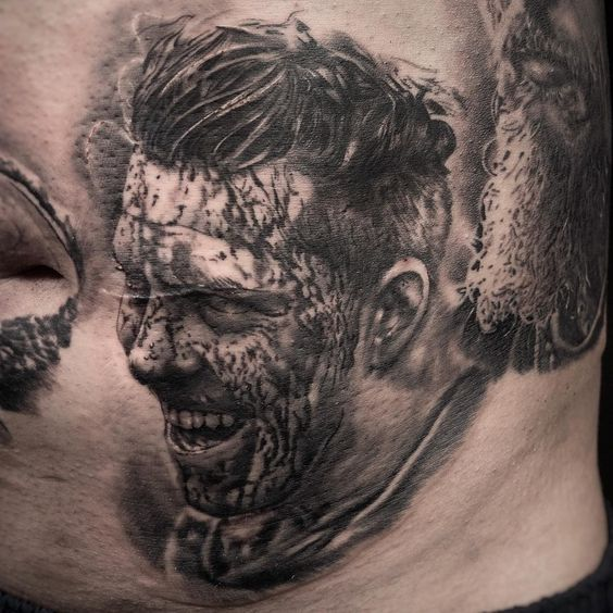 Grinning Viking Warrior Covered in Blood Stains tattoo