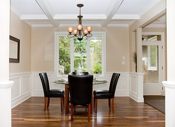 Dining room with hardwood and two tone walls with molding for 2 tone dining room colors