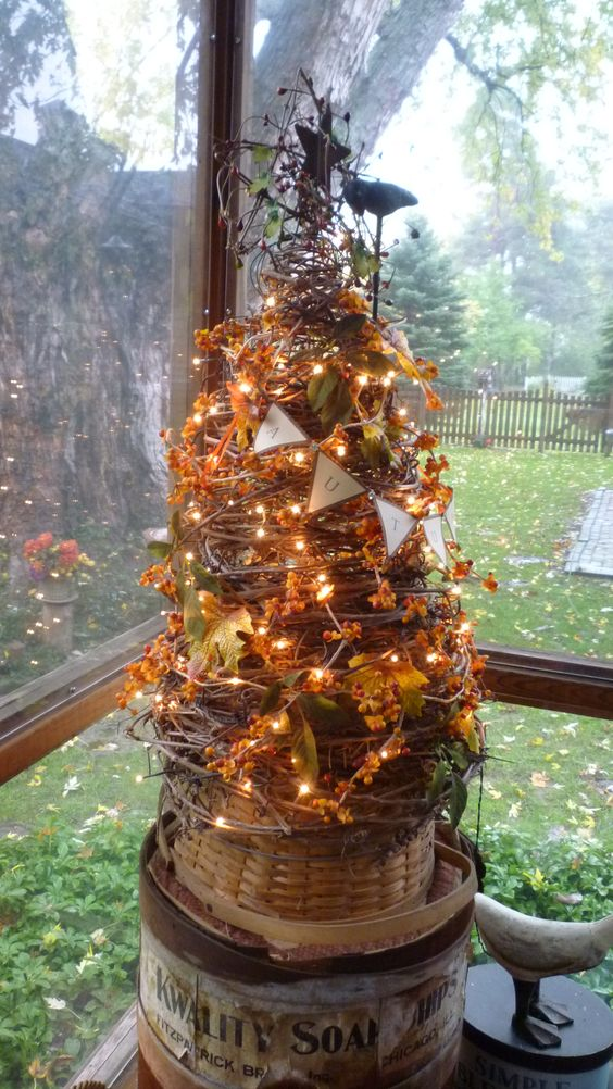 grapevine tree decorated for Fall (like concept, try one for the shows?  have some crows that wld be perfect for...)