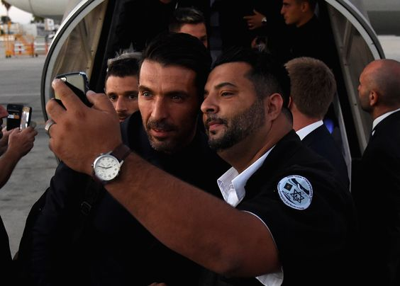 Gianluigi Buffon of Italy pose for a selfie as he arrives in Israel on September…