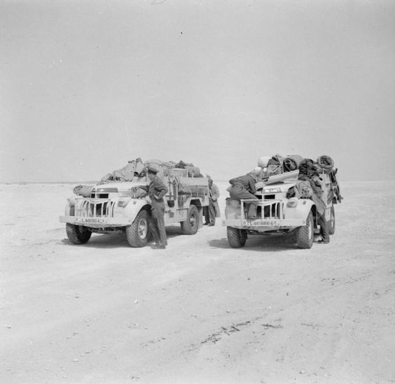 BRITISH ARMY NORTH AFRICA 1942 (E 12353)   Two fully loaded LRDG ( Long Range Desert Group) Chevrolet 30cwt trucks, 25 May 1942.: