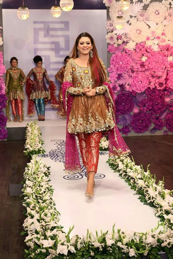 Dark brown embroidered short frock with red banarsi capri