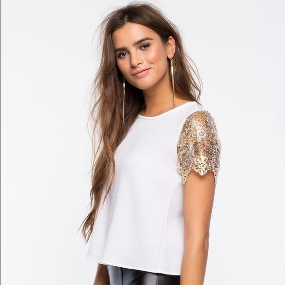 Gold dipped crochet tee Transform your look to golden with this stunning blouse, featuring gold crocheted short sleeves and an open tulip back. Finished edges. Looks killer with liquid skinnies, gold accents, and single-sole heels. Tops Blouses