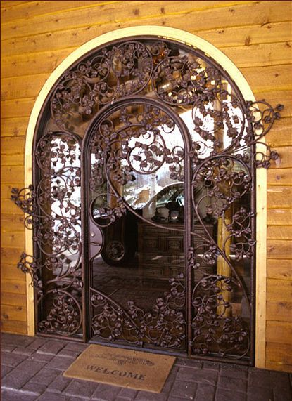 iron leaf door entrance. This would be awesome if the outer part was rounded, like a hobbit door!