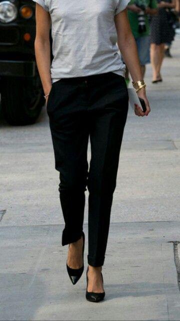 Weekends   Grey t-shirt, black trousers, black pointy Cap-toe pumps.