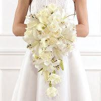 Eu gosto deste branco. Poderia ter uma pitada daquelas flores azuis bem pequenininhas?