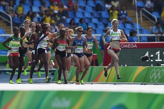 Britain's Laura Whittle (R), USA's Kim Conley (3R), Kenya's Helen Obiri (C), and Turkey's Yasemin Can(5L) compete in the Women's 5000m Round 1 during the athletics event at the Rio 2016 Olympic Games at the Olympic Stadium in Rio de Janeiro on August 16, 2016.   / AFP / Jewel SAMAD