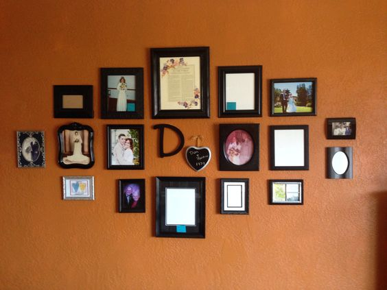 My wedding picture wall. The little heart will have the name/date of recent weddings or anniversaries.