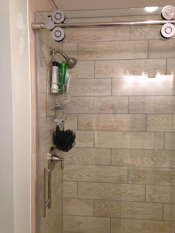 Wood tile in shower stall _ marazzi Home Depot, glass door is ...