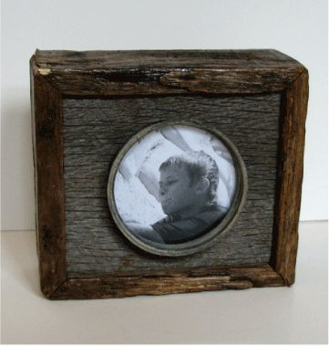 Frame made from old barn siding and zinc canning lid. findshtuff.com