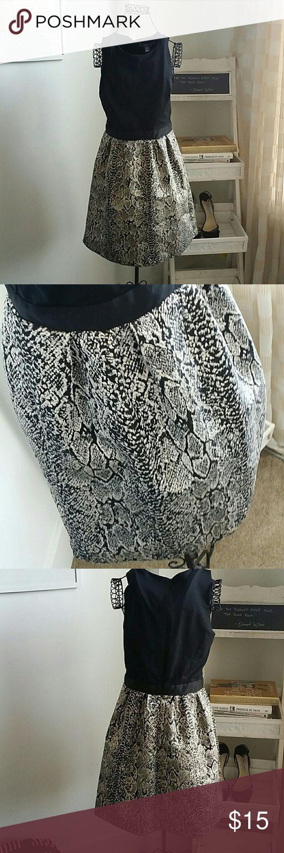 Donna Ricco Black Sleeveless Dress Black Sleeveless Dress with Snack Skin Printed Bottom. Great condition, non smoking home, stretch bodice. Size 5. Donna Ricco Dresses Midi