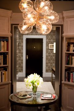 Chandelier from Big and Carrie's library: Handblown glass and gold lighting fixture is for sale at Lindsey Adelman's Web site; $15,360. Photo: Craig Blankenhorn