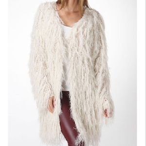 Who loves fur?! get this fringe cardigan now at thespottedzebrastore.com #fur #fringe #cardigan #fallfashion