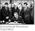 """[picture of Johnson signing the Civil Rights Act] A Biography of America, program 24, """"The Sixties"""""""