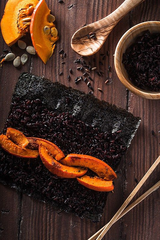 Give your Sushi a little twist and try this black rice, roasted pumpkin suhi version. It does not only look bad ass, it's goddamn delicious: