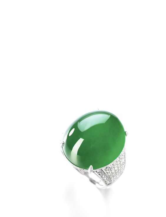 Important Jadeite and Diamond Ring  Set with an oval jadeite cabochon of high…
