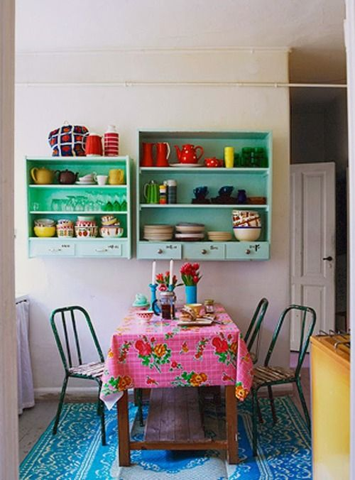 colorful kitchen dining room mint green shelves vintage pink table cloth retro