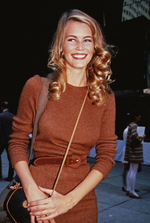 Schiffer works 1990s power-dressing in this maroon-brown coloured jumper dress, 1992