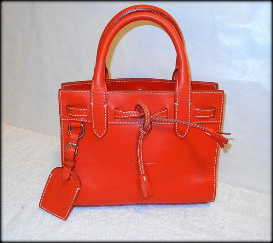 'Rare $300 Dooney & Bourke Orange Leather Satchel – EUC' is going up for auction at  8pm Mon, Apr 14 with a starting bid of $25.