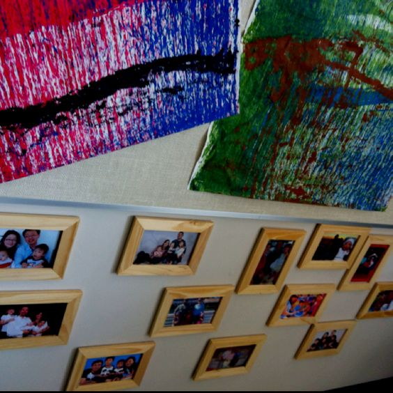 Having students bring in their family pictures and displaying them in class at the students' level. #Reggio