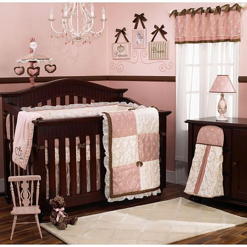 Adorable, I love pink and brown and having a chandelier in there, just not right over the crib....