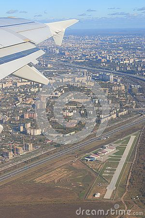 View of the city and a small airfield from the aircraft. Saint-Petersburg…