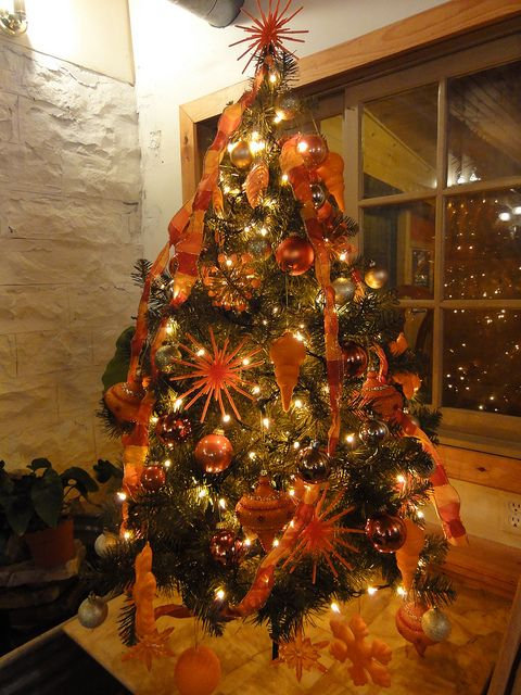 Orange Christmas tree, this is my tree,although smaller and with blues to match my home decor <3 it so much