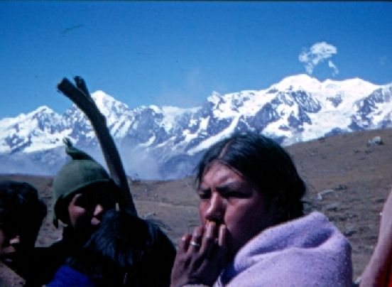 Bolivia - Some years ago I backpacked my way around South America. One way I got close to the marvellously hospitable Indians of the Andean countries was by sharing their discomforts when travelling in the backs of open trucks, as here with Ayamara in a truck near Illampu in the freezing cold at 15,000 feet above sea level