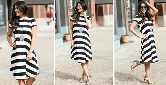 """Breeze through the season in our Striped Swing Dress! With a bold 2"""" stripe…"""