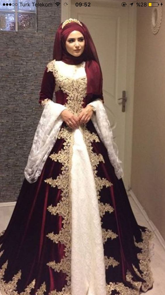 Love the split skirt, lace cuff on sleeves and square neckline.
