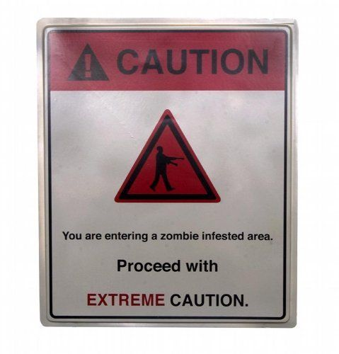 """Extreme Caution Zombie Infested Area 19x16 Halloween Decoration Sign by Morbid Enterprises. $7.79. These Extreme Caution Zombie Infested Area Street Signs are an awesome decoration for Zombie themes! These are a full 19 x 16"""" size and made of plastic, great to create your 'ground zero' or 'contamination zone', or just to complete the overall theme indoor or out. Great on their own, and even better with the other decorations, costumes, and accessories in our store!. Save 57%!"""