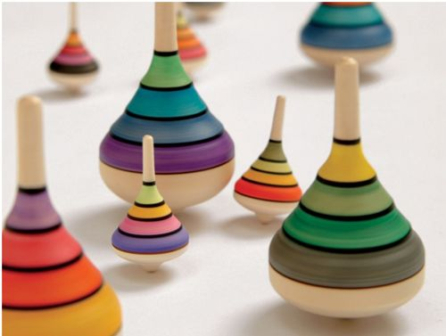 wooden spinning tops: These Mader Tops are handcrafted in Austria from a variety of woods native to Europe. Each top is made from a single piece of wood and is then hand painted in beautiful colour combinations. (You can read more about them here.) They're so well made that they spin for minutes at a time. Fun! And also pretty just sitting on a shelf.  They're available from Couverture in the UK and from Pucci Manuli in the US.