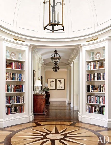 The rotunda in a Houston mansion is lined with bookshelves and features an inlaid compass rose embellishing the floor.