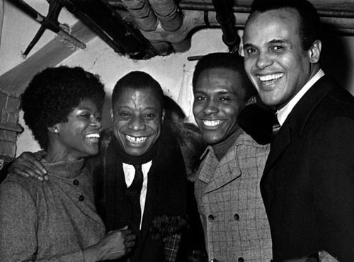 """Cicely Tyson,James Baldwin,Arthur Mitchell(dancer and founder,Dance Theatre of Harlem) andHarry Belafonteattend the """"To Be Young, Gifted And Black"""" gala on January 2, 1969 at the Cherry Lane Theater in New York City. Photo by Ron Galella, Ltd./WireImage."""
