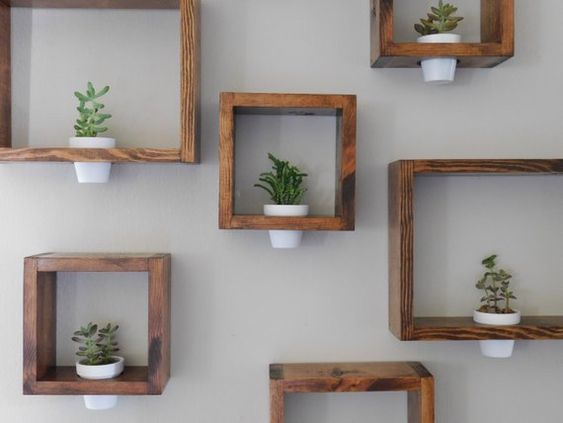 Wooden Wall Planter! Perfect gift for any occasion! This petite wall planter will brighten up any space in your bedroom or office. Can be sold as 1 or a set as well as different dimensions and in various stains. The framed plant holder, plant and pot are included! Have your own pot