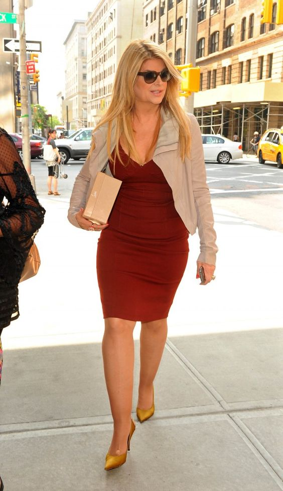 Kirstie Alley - a bigger girl who dresses in a beautiful, feminine style. I don't have her hourglass shape, though!