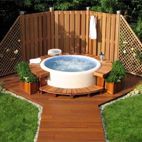 Fence Backing a Soft-Walled Hot Tub