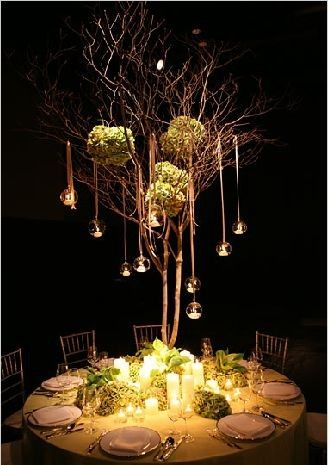 tree centerpiece- love how the cradles light the table