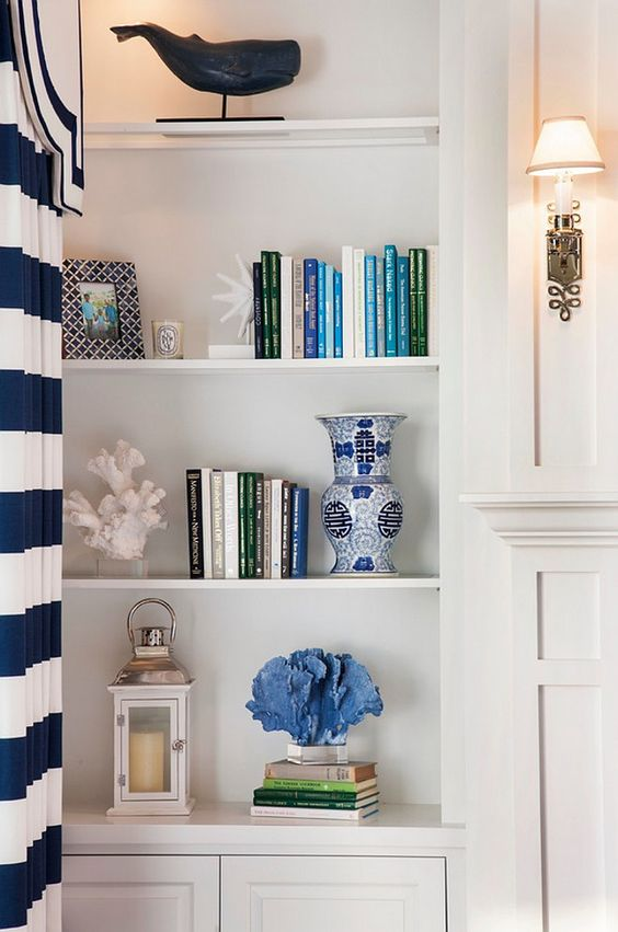 White Bookcase Paint Color. The white bookcase paint color is Sherwin Williams Pure White SW7005. This white paint color is a great crisp white that I often recommend to my own clients. You can use this crisp white on cabinets, but it is also perfect from trim work.: