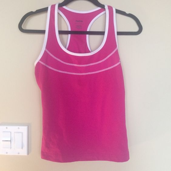 Reebok workout tank top w built in bra support Bright pink workout sports tank top with built in bra support. Size small. 88% polyester 12% spandex Reebok Tops Tank Tops