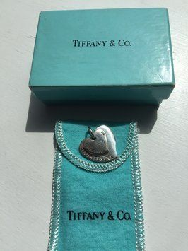 (*Trusted Tradesy Seller*) TIFFANY & CO. Double Heart Pendant Charm with Tiffany Box and Pouch. Get the lowest price on (*Trusted Tradesy Seller*) TIFFANY & CO. Double Heart Pendant Charm with Tiffany Box and Pouch and other fabulous designer clothing and accessories! Shop Tradesy now
