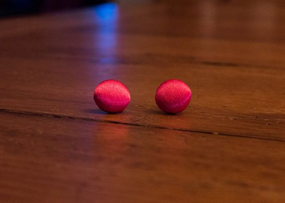 These bright pink earrings will make any outfit pop! They are made of fabric covered buttons, covered in shiny hot pink taffeta material measuring