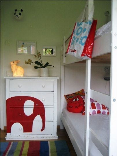 Painted elephant dresser. Could be any animal really! White walls white dresser. Pop of color. Apartment therapy