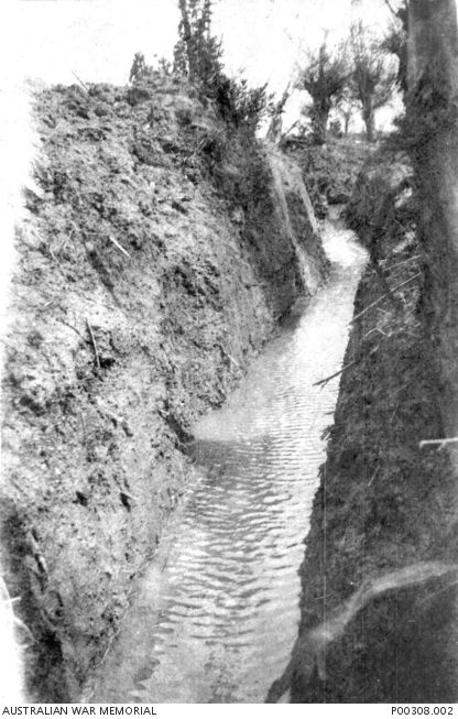 Images from the Somme Offensive 1916.  A water filled trench in the Somme area.