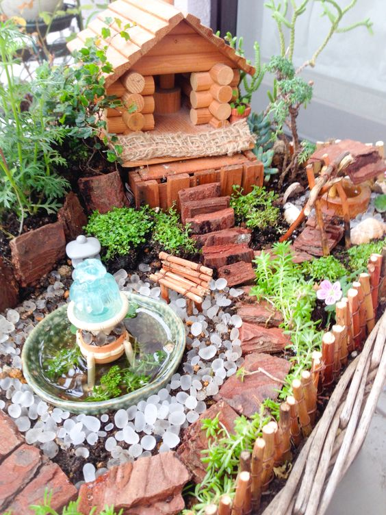 My mini loghouse landscape will surely attract fairies!