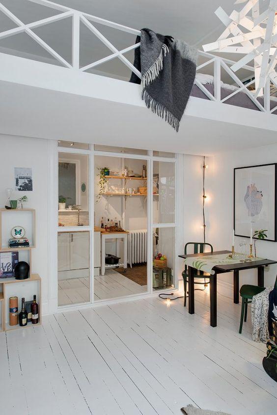 Une cuisine semi ouverte avec une porte vitrée sur une salle à manger style scandinave /  / kitchen/ livingroom