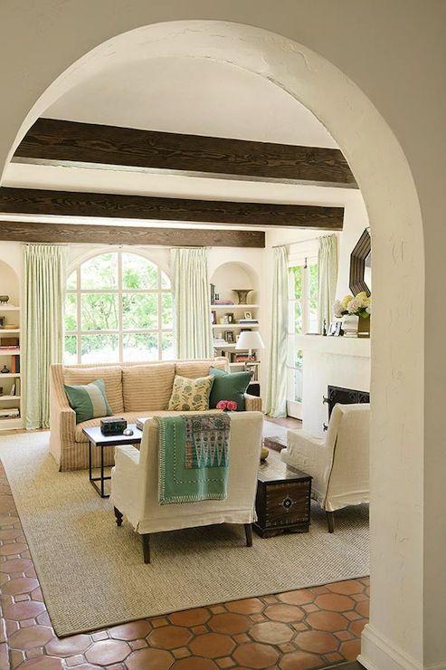 dark stained wood beams, hex terracotta floor