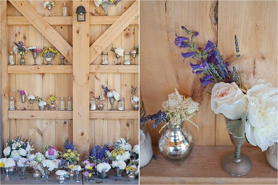 small arrangements lignin the walls of the barn. simple elegance