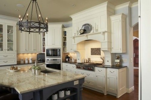 Like the mantel over the stove and the white cabinets with the dark granite.  How about that chandelier?